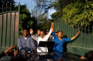 aristide-dr-maryse-narcisse-lavalas-presidential-nominee-on-pickup-truck-outside-his-home-093015-by-dieu-nalio-chery-ap