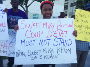 protesters-outside-haitian-presidential-debate-denounce-aug-9-election-miami-100415-by-haiti-information-project